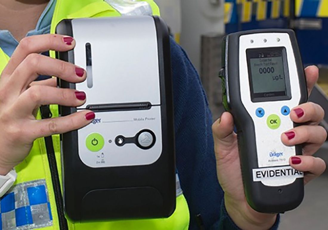 Police hand-held breathalyzer machine