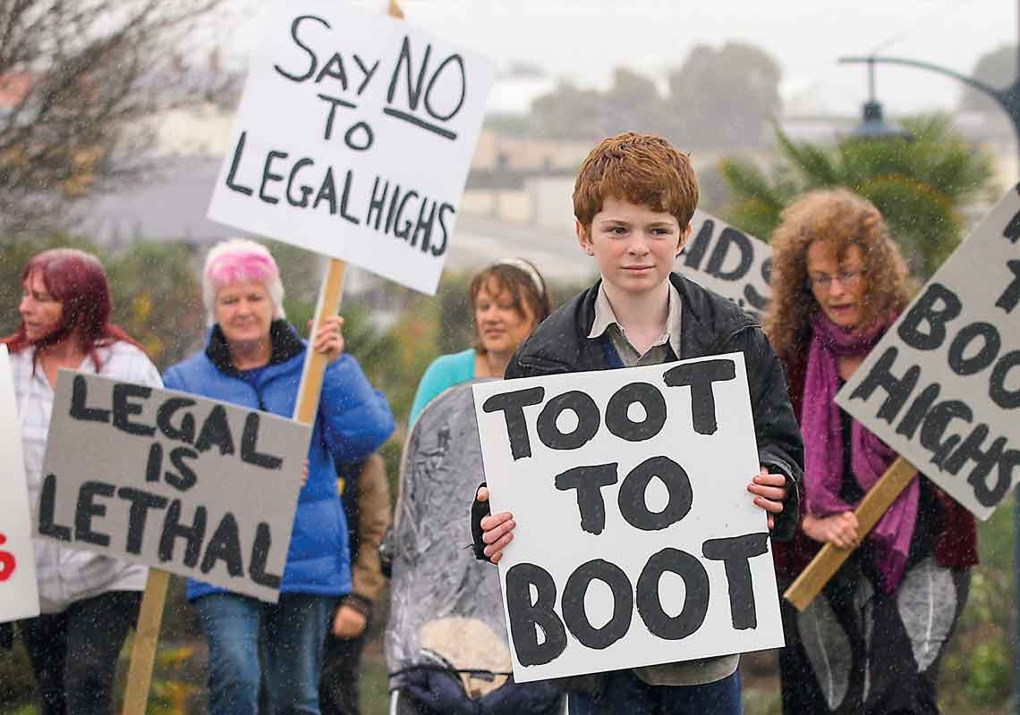 Protesters hold up placards proclaiming Say no to legal highs, Toot to boot and Legal is lethal