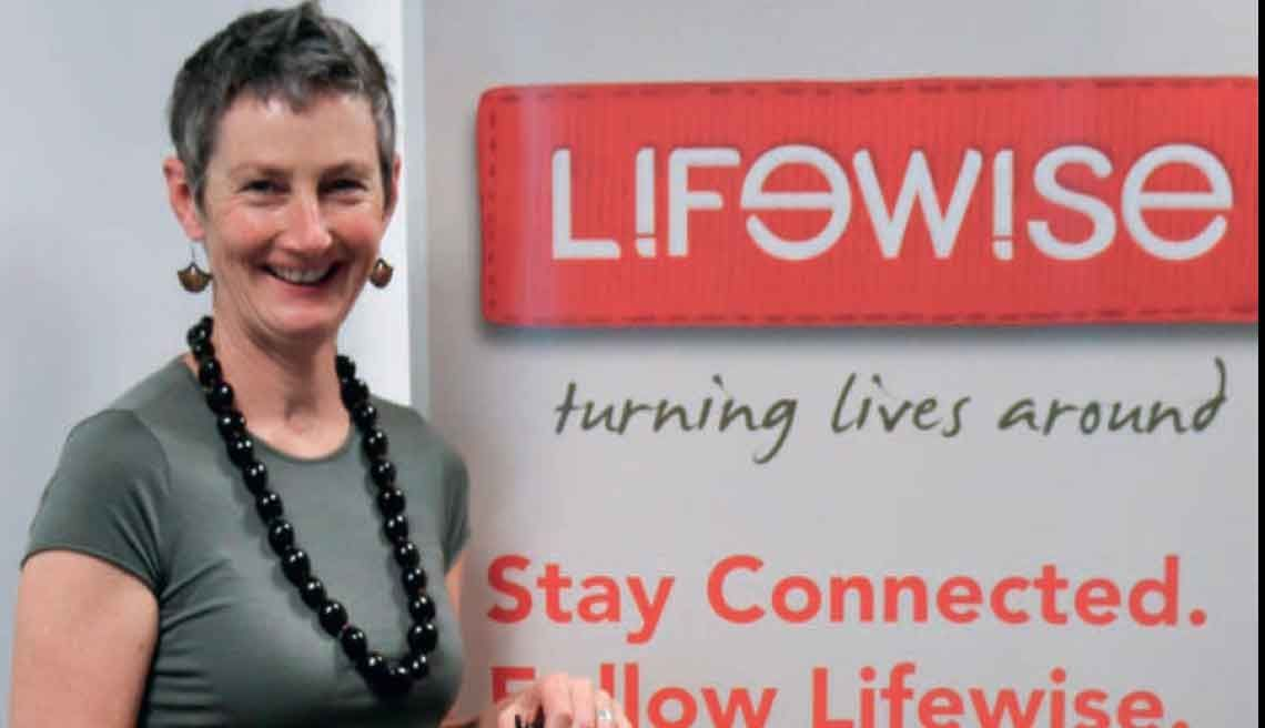Moira Lawler, standing by Lifewise Trust sign.