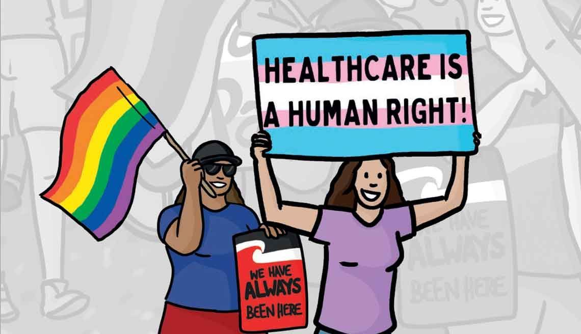"Two women hold colourful placards reading ""healthcare is a human right!"" and ""We have always been here"" and a rainbow flag, against a greyscale backdrop of rally participants"