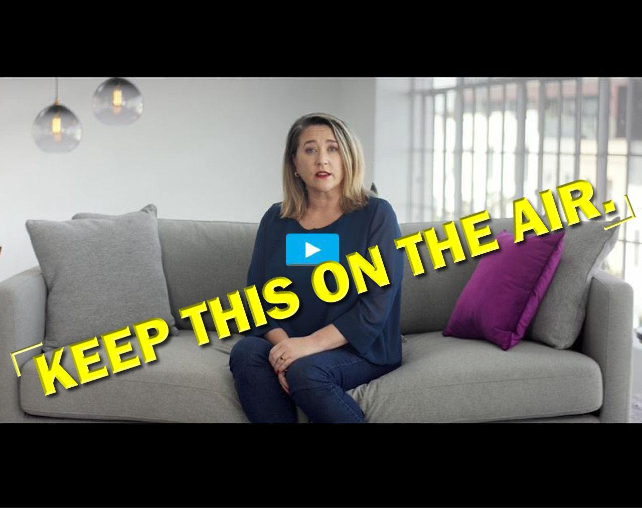 "Video still from OOT campaign with stamp ""HELP KEEP THIS ON THE AIR"""